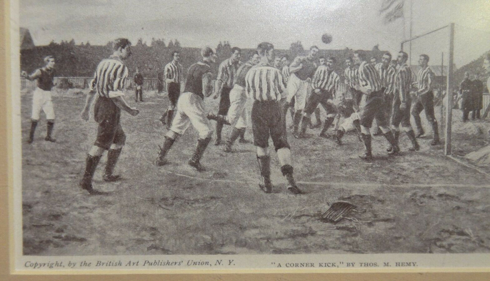 A portion of the framed print - 'A Corner Kick'.