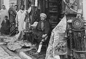 Garrigues image (I think) - Arab Bazaar in Tunis - Can anyboby confirm the photographers name from the difficult text at bottom left?